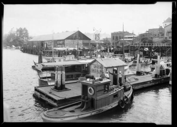Pleasure boats with Union Oil station, Nanaimo, British Columbia, Canada, 1935