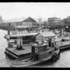 Pleasure boats with Union Oil station, Nanaimo, British Columbia, Canada, 1935