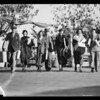 Crowds walking to & from sale, Southern California, 1936