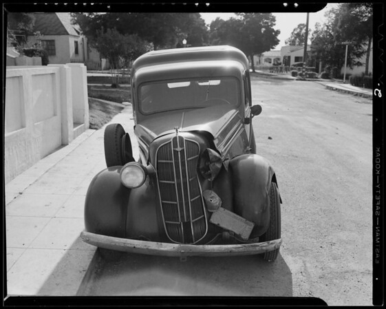 Intersection of Ramona Boulevard and Gravois Avenue and wrecked 1936 Dodge panel truck, Los Angeles, CA, 1940