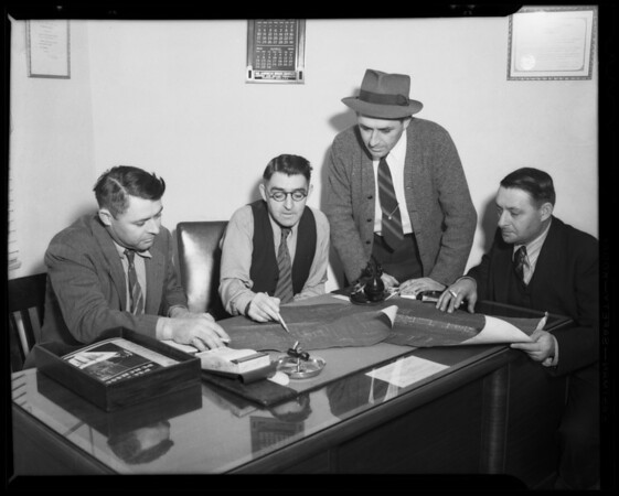 Belyea brothers in conference at desk, Southern California, 1940