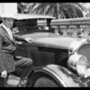 Man with car, Indian lettering on hood, Southern California, 1926