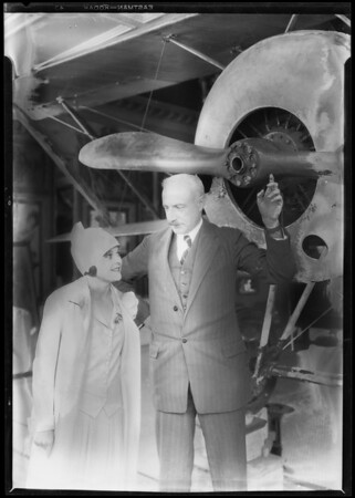 Barbara Kent & Nungesser plane in lobby, Southern California, 1927