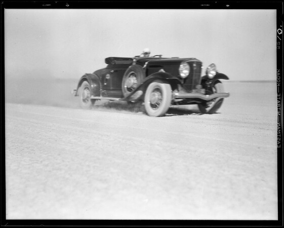 Studebaker making run on dry lake, Southern California, 1931