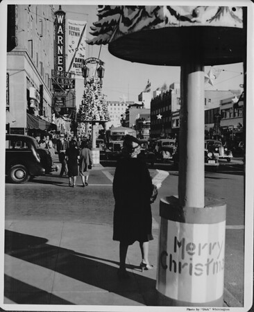 "Hollywood Boulevard at Christmas time, with the Warner Hollywood Theatre playing ""The Dawn Patrol"" with Errol Flynn, ca.1938-1939"