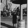 """Hollywood Boulevard at Christmas time, with the Warner Hollywood Theatre playing """"The Dawn Patrol"""" with Errol Flynn, ca.1938-1939"""