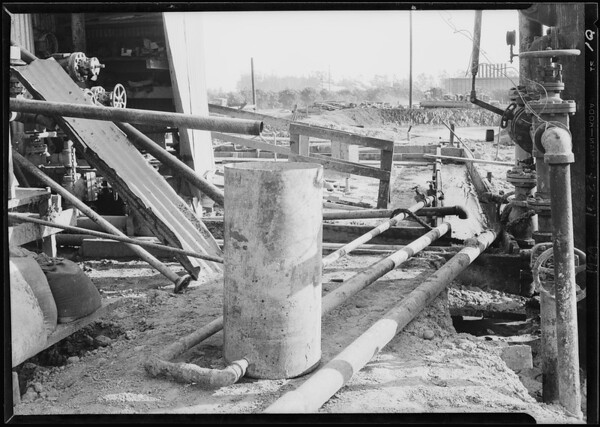 Set ups for mixing gelatine like composition in wells at Santa Fe Springs, also zublin bit, Southern California, 1929