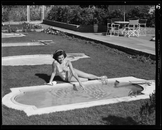 Model pool on Ventura Boulevard at Sepulveda Boulevard with girl, Los Angeles, CA, 1940