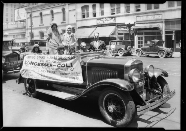 Barbara Kent & Nungesser plane in lobby, Southern California, 1927