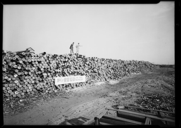 Wall of discarded heater tanks, Southern California, 1930