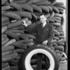Mr. Price and stack of old tires, Southern California, 1930