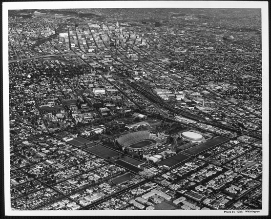Aerial view facing northeast over Exposition Park looking into Downtown Los Angeles