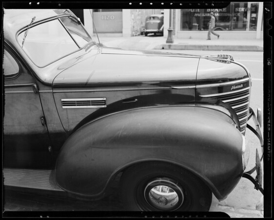 Mark on fender of 1935 Plymouth owned by Kelly Springfield Tire Company, 1127 South Olive Street, Los Angeles, CA, 1940