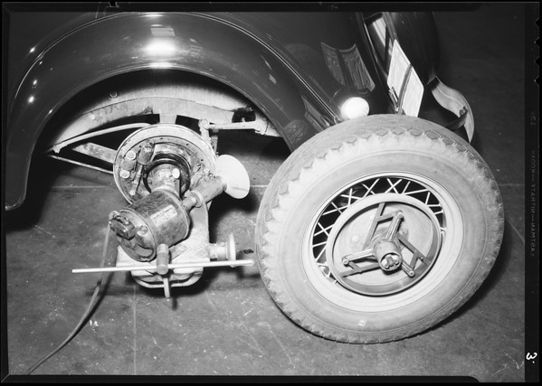 Installing hydraulic brakes on a Ford V8 & demonstration rack, Southern California, 1934