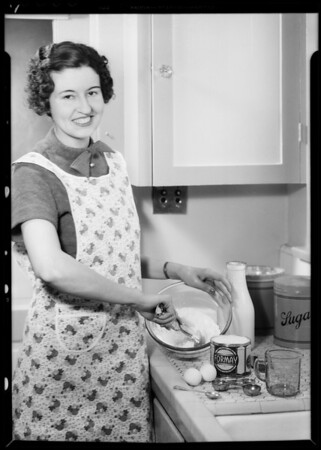 Mrs. Roscoe Turner baking with Formay, Southern California, 1935