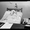 Mr. Wells in hospital bed and close-ups of bandaged head, Southern California, 1940
