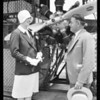 Lady Heath inspecting motor, Southern California, 1929