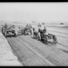 Mules pulling construction wagons, Pico Boulevard Heights [Picfair Village], Los Angeles, CA, 1925