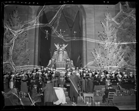 Mayor Bowron switching on Christmas Tree Lane lights and chorus, Los Angeles Memorial Coliseum, Los Angeles, CA‎, 1940