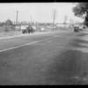 Skid marks, San Fernando Road, and car, Southern California, 1931