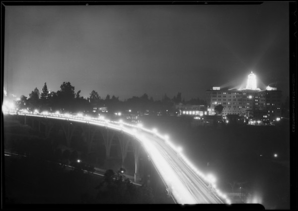 Arroyo Seco bridge and Vista Del Arroyo hotel at night, Christmas lights, Pasadena, CA, 1930