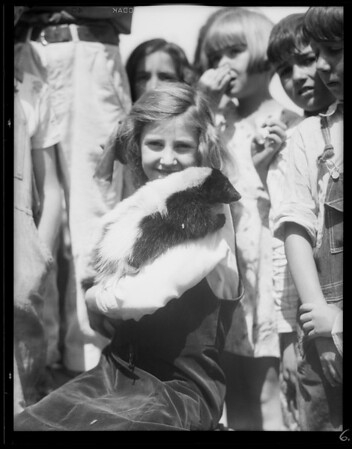 Boys and animal pets at playground, Southern California, 1931