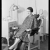 Girl wearing apron in beauty parlor, Southern California, 1931