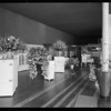 Flowers etc. at opening of new store, 10th Street [Olympic Boulevard] and Hope Street, Los Angeles, CA, 1931