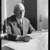 Mr. Weymouth looking over maps, Metropolitan Water District, Southern California, 1931
