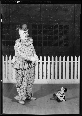 Clown & toys, Southern California, 1930
