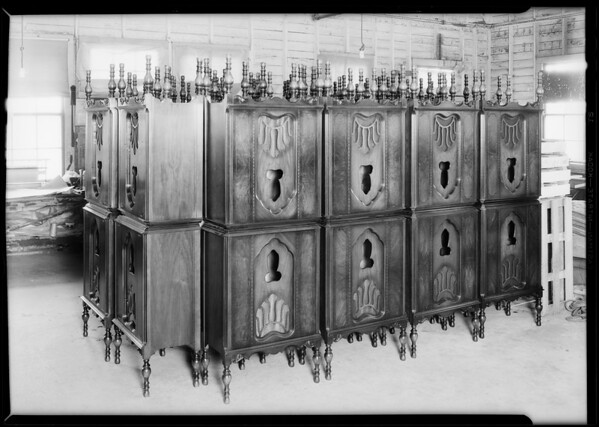 Radio cabinets stacked up in aisle, Southern California, 1930