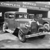 Chandler sedan, Universal Auto Insurance, garage at Olive Street and East Broadway, Glendale, CA, 1931