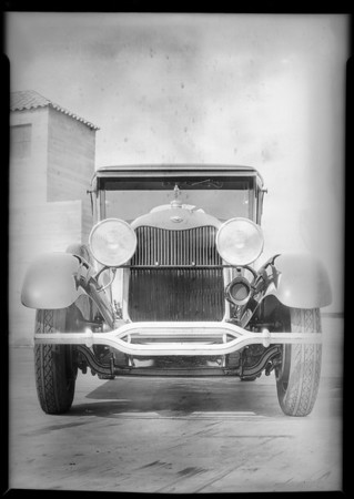 Lincoln car on roof of building, Southern California, 1928