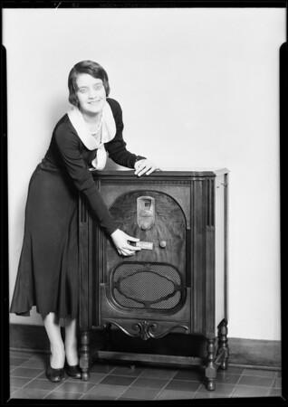 Girl putting plates on radio, Southern California, 1930