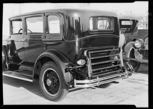 Rear view Packard automobile and trunk, Southern California, 1929