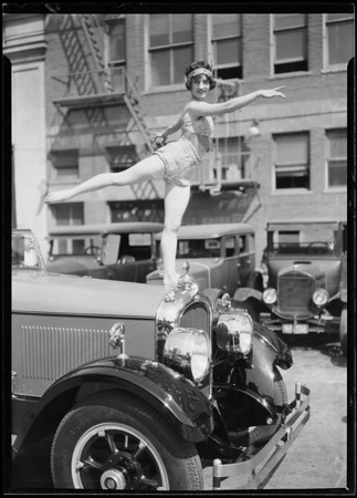 Marmon with dancer on radiator, Southern California, 1926