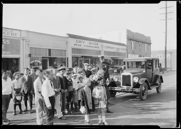Chevy with Helen Bennett, school kids at 6th Avenue and West Jefferson Boulevard, Southern California, 1925