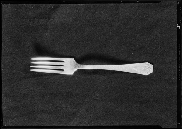 Rugs, cutlery, etc. for ad, May Co., Southern California, 1931