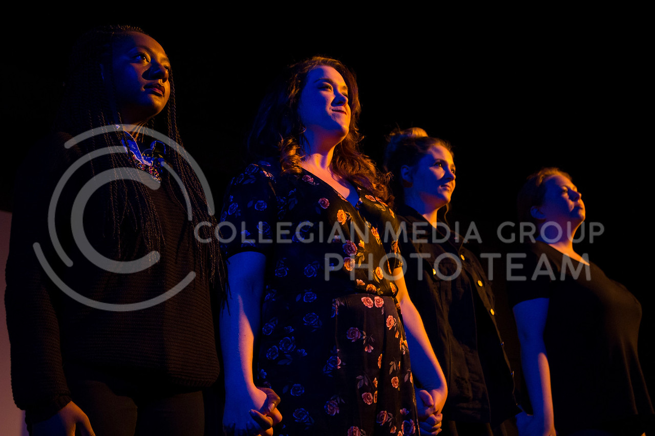 """Holding hands, the cast stands together to end their performace of """"Who Will Talk to the Boys?"""". The show was held in The Purple Mask Theatre on March 1, 2018. (Andrea Klepper 
