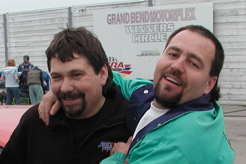 Fooling around with Joe Boniferro at the Pro Mod Warz event at Grand Bend in 2003.