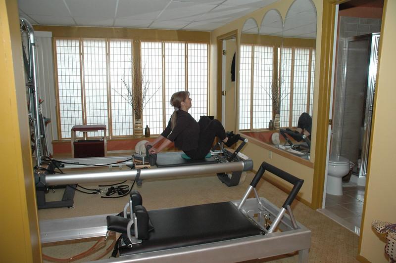 Stomach Massage Hands Back on Reformer