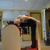 Ballet Stretches on Ladder Barrel