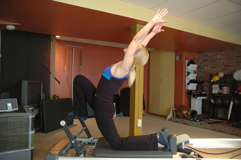 Front Splits In Back Bend On Reformer