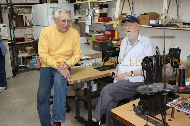 Bill and Bob discuss designs near their 100 year old Singer sewing machines that they use on a daily basis.