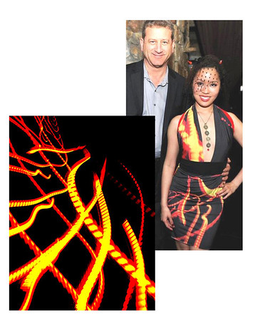 David with Jessica Young wearing a dress made with a print of lights in the Yerba Buena Tunnel, design by Ashton Miyako.