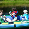 Julie, Morgan, and Lewis in the boat