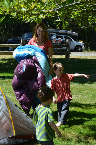 Theresa, Chester, and Jack setting up camp
