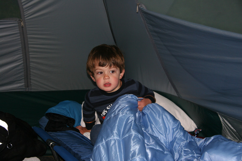 "This shot was taken when Lewis totally faked me out. I was so sure he was going to go to sleep, and that I was going to be the hero of the evening by having Dave or Pauline collect him from Nigel and my tent in a deep sleep.  He was just messing with me and now it was ""time to wake up."""