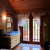 Jade Palace Master Bedroom - French Doors look out on property and pond