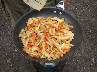 A frying pan full of wild mushrooms.
